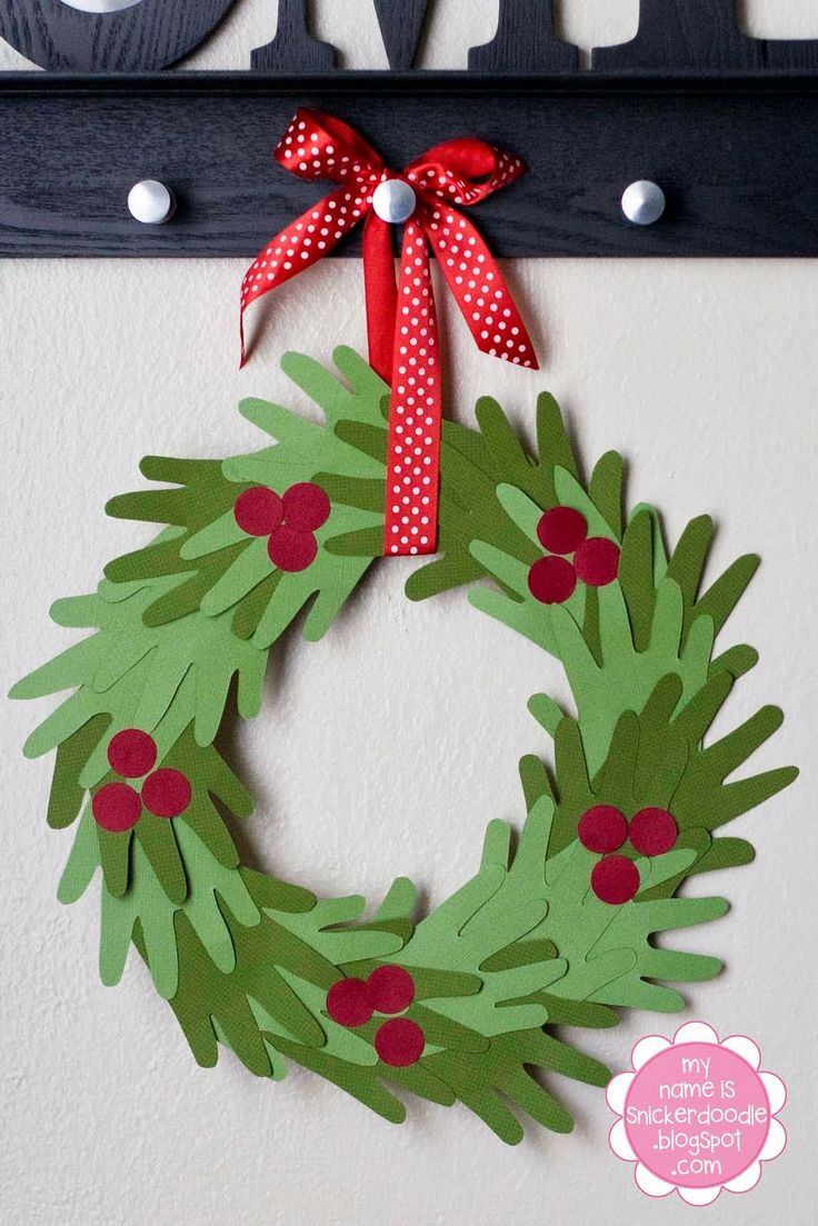 Hand Print Wreath...Perfect Kid's Craft for Christmas! | Or wreath with all hands for classroom?