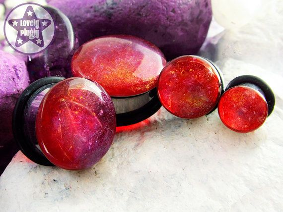 Dragons Breath Fauxpal fake opal plug / gauge in red translucent with blue, purple and gold swooshes. 0g, 00g, 7/16 / 8mm, 10mm, 11mm 316L Surgical