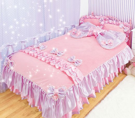 Bedding: Purple and pink. Ruffled bed skirt.