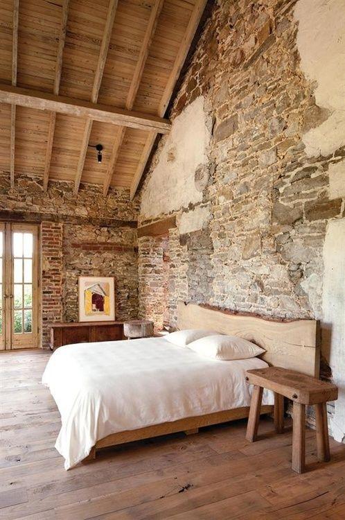 Exposed brick master bedroom natural headboard, ceilings!