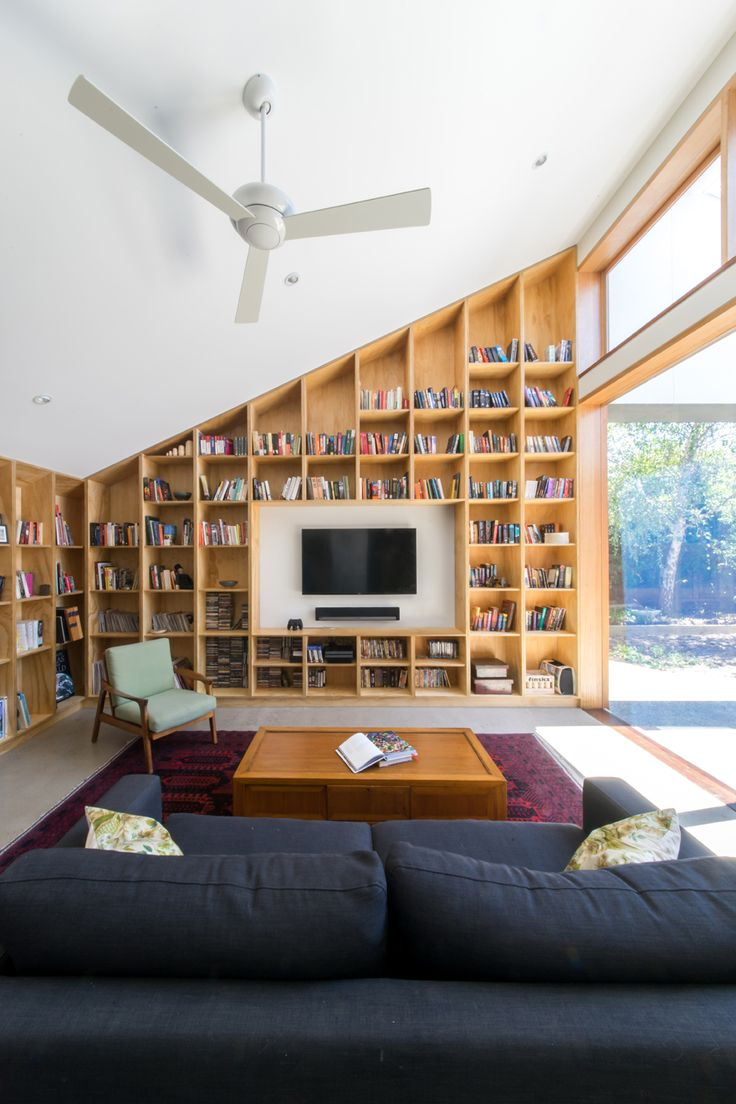Wordsmith by windust architecture + design.  Built-in book wall stores clients' large collection of books.