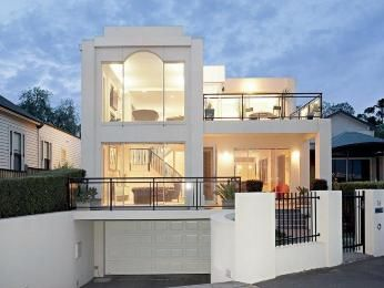 Glass modern house exterior with balcony & hedging - House Facade photo 494205