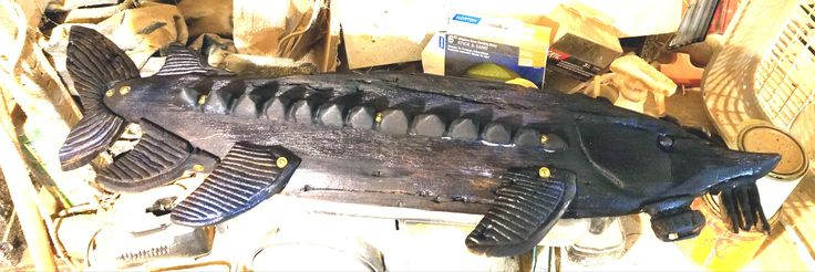 Making a Lake Sturgeon out of 1900 barn wood, burnt with a torch and brushed with a wire brush