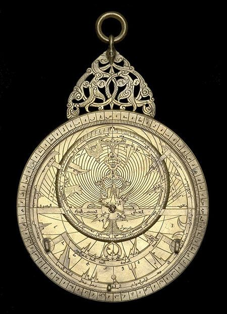 Astrolabe with geared calendar, ca.1221/22. This 13th century Persian astrolabe is the oldest complete device with cog wheels known. On the front side it is an astrolabe, linked to the calendar by a gear train. On the back, the disc shows the phases of the Moon | Oxford, Museum of the History of Science
