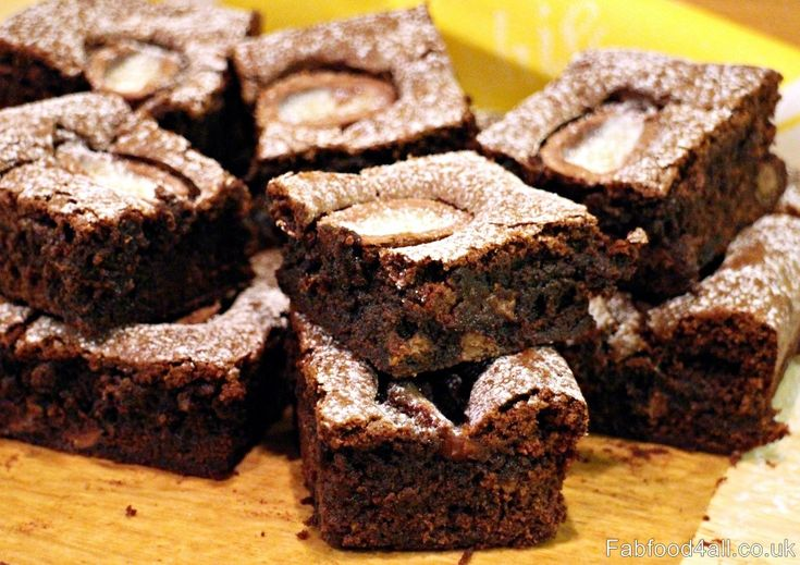 Creme Egg Chocolate Brownies contain creme egg & milk chocolate chunks & are adorned with mini creme eggs - gooey, chewy and everthing a brownie should be!