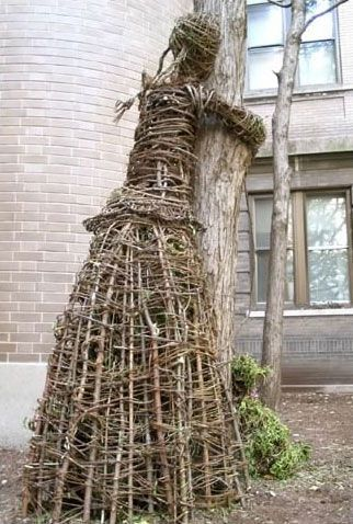 may as well have a tree hugger or two in your garden!!!!! hehehe.... :-)  the *tree hugger project*.....wiktor szostalo and agnieszka gradzik create art pieces that are literally tree huggers.....twigs, vines, sticks and branches woven together and entwined to create wicker people that wrap their arms around tree trunks........ :-)
