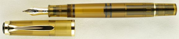 Pelikan Tradition M200 Cognac. With its cognac-colored resin and smooth 18k nib, this fountain pen beckons the writer to linger just a little bit longer on the hand-written word. Gold trim highlights the warmth of the amber color, while the translucent barrel allows you to see when it's time for an ink refill. $299 for this generous piston-filler.