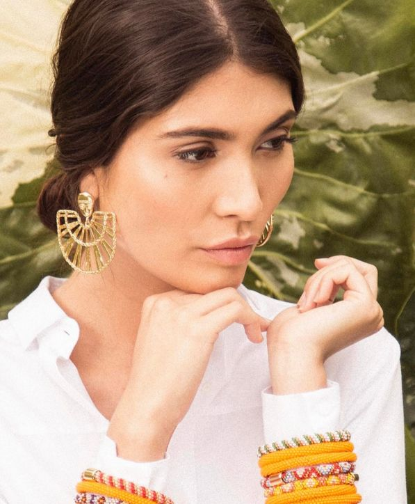 """The """"bird man"""" earring.   Designed by Maria Paulina and made by women in remote indigenous tribes, like the Embera Chami and the Kuna Tule women in Colombia. Each piece embraces the traditional ancestral skills unique to different tribes and allows the women to support themselves financially."""
