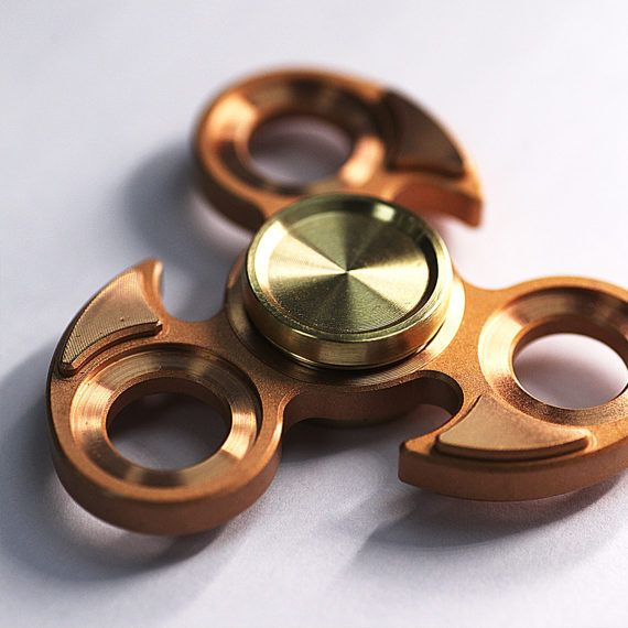 Alquar Fidget Spinner! Specs: Color:Copper Body Material: 100% copper Button material: 100% brass Spinning time: over 3.5 minutes Bearing Size/Type: 606 Features: —— Designer Concept - Eagle Eye :Sometimes life is complicated like mist covering the truth. We wish we have the eagle eyes that is sharp and with the wisdom to reveal the reality and live with no confusion. —— Surface Finishing - To achieve the ever best appearance performance we are chasing for, Complicated Abrasion Blastin...