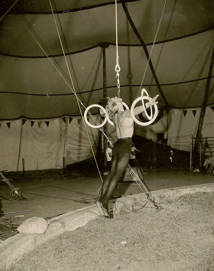 This performer is doing a 'dental' act - similar to the sort of act that the character Vytas Gatevackas performed in the novel Zarconi's Magic Flying Fish.