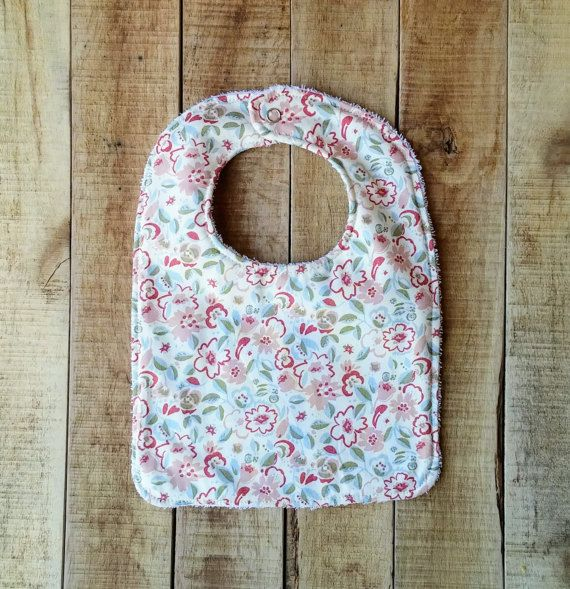 Fashionable and practical! This is a beautiful accessory while practically keeping your babys outfit drool, food and spit up free. This beautiful floral print Bib makes a unique and cherished shower gift that would be well used and very handy for any new mom.  I was recently inspired by my own children's need for a good quality bib that had a good amount of coverage. This stylish bib is great for the messy blessings The bib is topped with 100% Cotton, backed with absorbent Terry Cloth and…