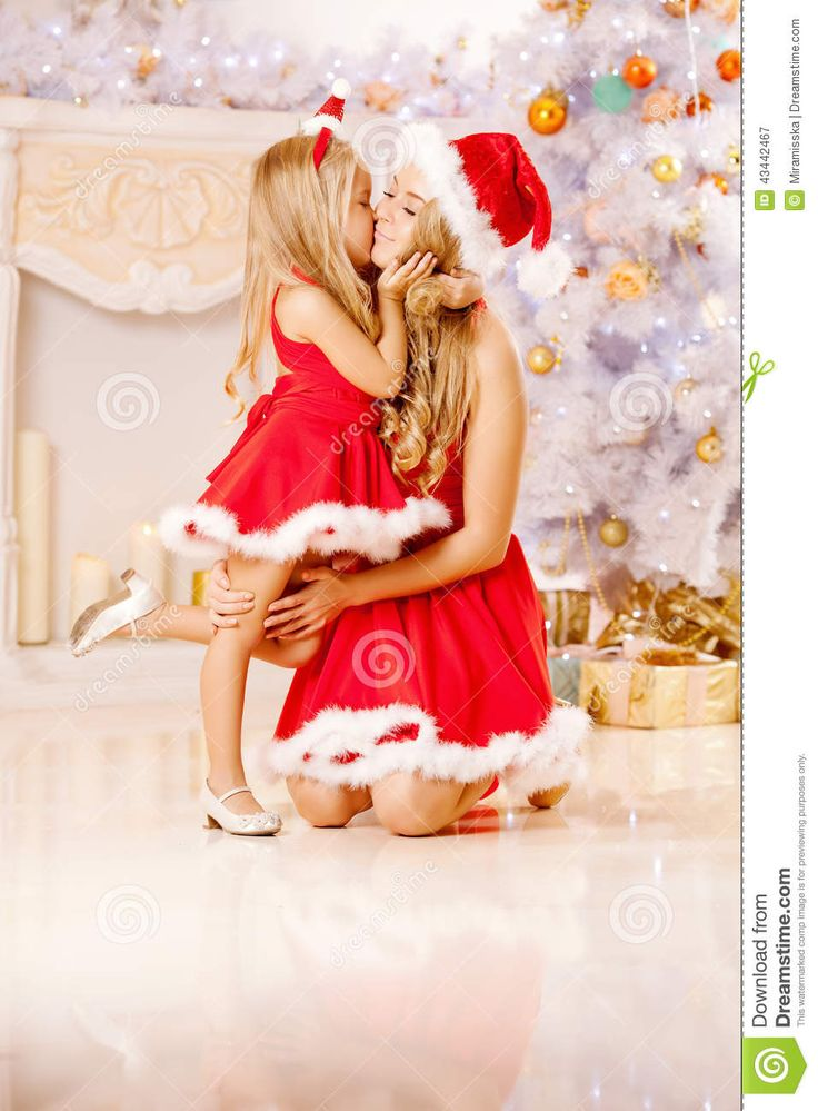 Mom And Daughter Dressed As Santa Celebrate Christmas. Family At - Download From Over 26 Million High Quality Stock Photos, Images, Vectors. Sign up for FREE today. Image: 43442467