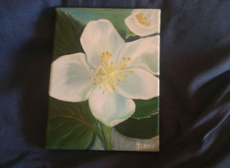 White flower painted on canvas
