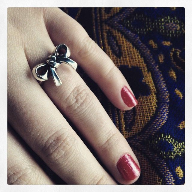 Feminine and playful, the Bow Ring looks charming on this ...