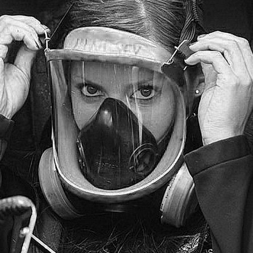 Leah Pruett fixing her Gasmask and getting prepared for Warm up