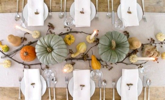 Festive gourds in different shades, tree branches and long tapered candles placed in mini pumpkins make up a beautiful minimalist autumnal table. Pumpkin Masters Carving Kits can help create holes with precision for holding each candle up. (http://www.pumpkinmasters.com/pumpkin-carving-kits.asp) Idea via Williams-Sonoma.
