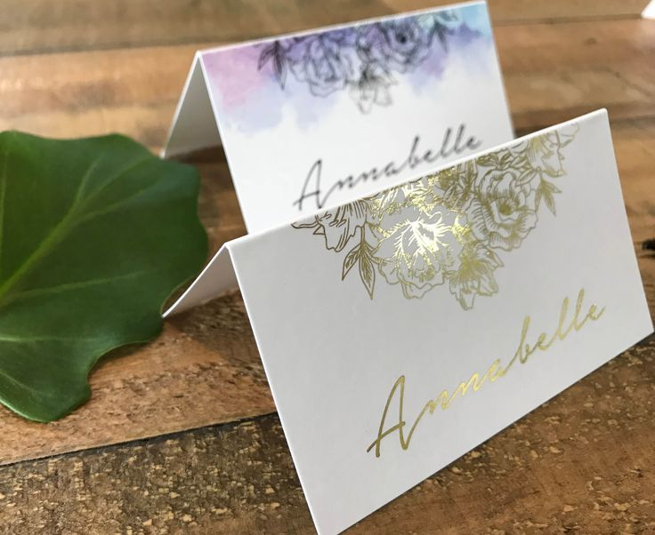 A gorgeous floral place card | tent card | escort card featuring a floral composition and gorgeous script font. Choose to have a fully foiled place card or to have a watercolour effect behind the flowers.