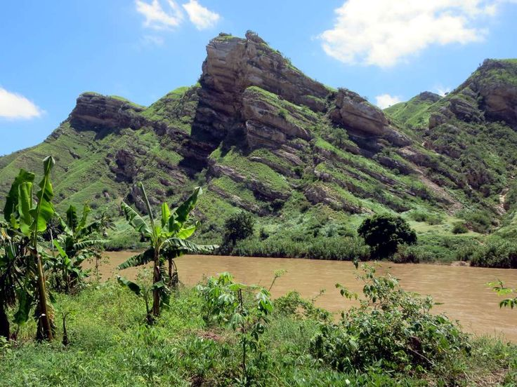 The Catumbela River passes scenic hills before entering the coastal plain in western Angola.