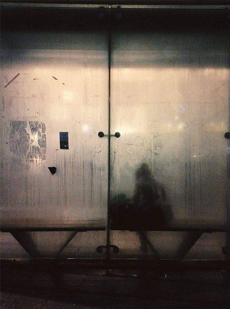 Julien Tatham is a french multidisciplinary artist. Inspired by the hidden beauty of urban life, he has decided to capture unknown people waiting for the bus. With his Smartphone, he highlights these fuzzy silhouettes posted behind misty bus shelters.