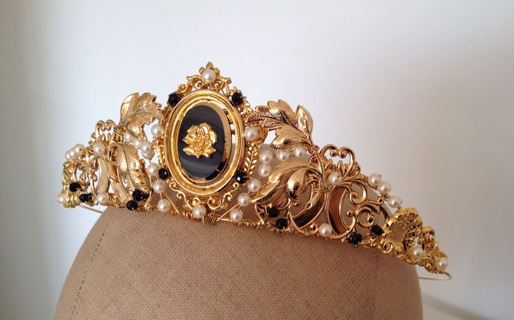 The Bath tiara by Samantha Walden A Regency-inspired piece with gold cameo, Swarovski pearls and black crystals