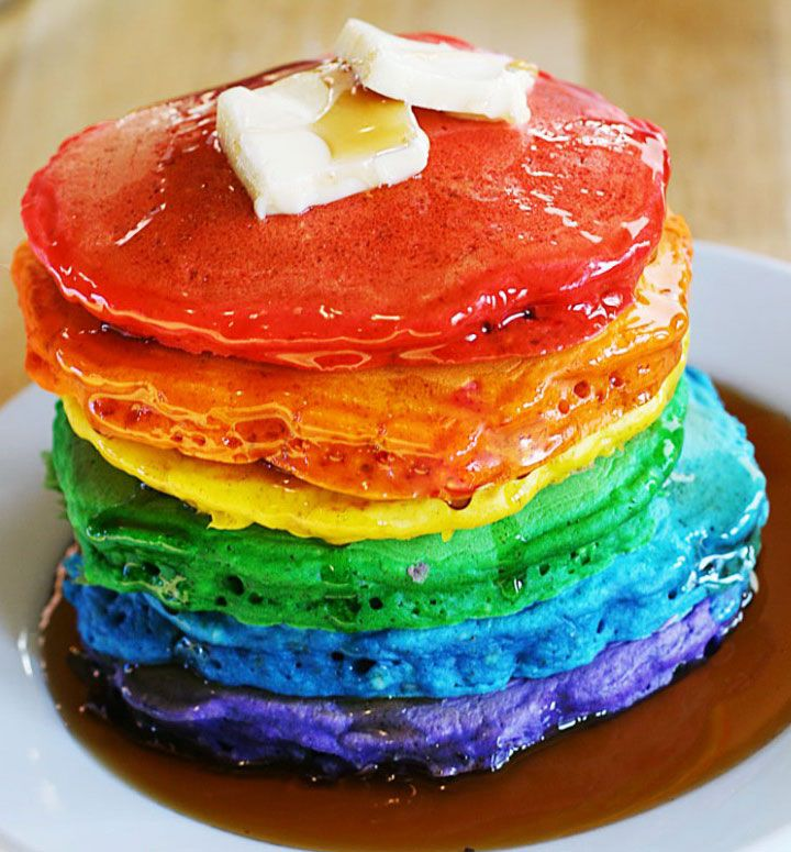 How cute! The link is a waste of time, this recipe is so simple. Just make pancake mix from the box and separate it out into bowls. Put a few drops of food coloring in each bowl to dye the pancakes and proceed as usual when making pancakes.