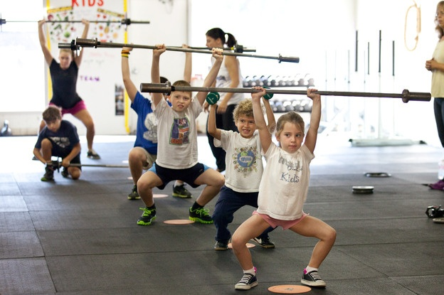 "CrossFit for Kids?? What do you think? ""If your kid wants to do CrossFit and the class has good trainers, that's just fine. But if your kid prefers doing cartwheels outside to lunges indoors, that's fine, too. The point is to make exercise fun and a part of everyday life early on."""