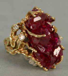 14K gold custom ladies ring, set with uncut ruby