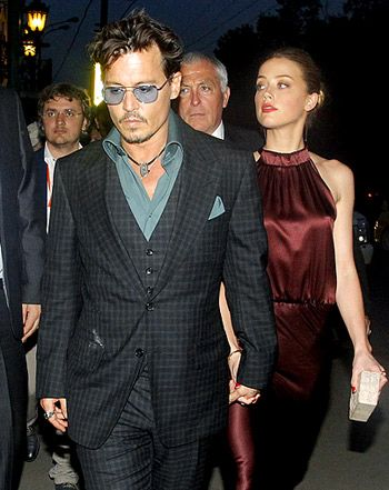 Johnny Depp, Amber Heard Hold Hands During Stunning Moscow Appearance