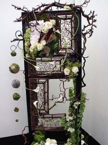 Use old door with flowers for a fall & country setting