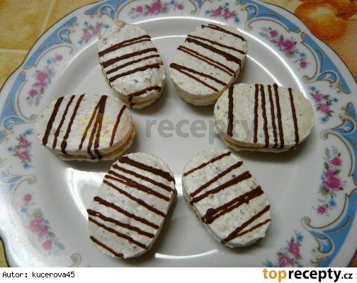 Kokosové laskonky6 bílků 330 g krupicového cukru 100 g moučkového cukru 170 g kokosu