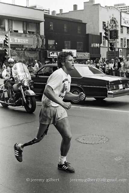 Terry Fox, during his Marathon of Hope, crosses Yonge Street at Bloor in Toronto, July 12, 1980.