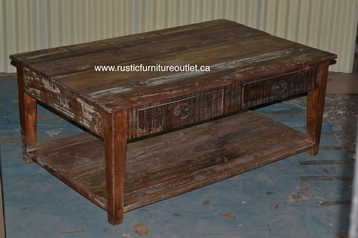 """Crafted from recycled wood solids in a multi-colored hand-painted finish ensuring bonafide originality, this coffee table offers the faded colors of an heirloom as well as an alluring rustic charm.   50""""L x 20""""H x 32"""" D COST 399$"""