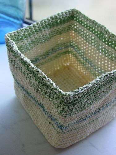 How to Crochet a Box - great way to use up yarn and get storage boxes: stiffen with wallpaper paste or liquid starch.  Also, I'd like to make this the same size as a cardboard box (cover the cardboard box with saran wrap and it can be used to help form the crochet box once it's soaked in the stiffener).