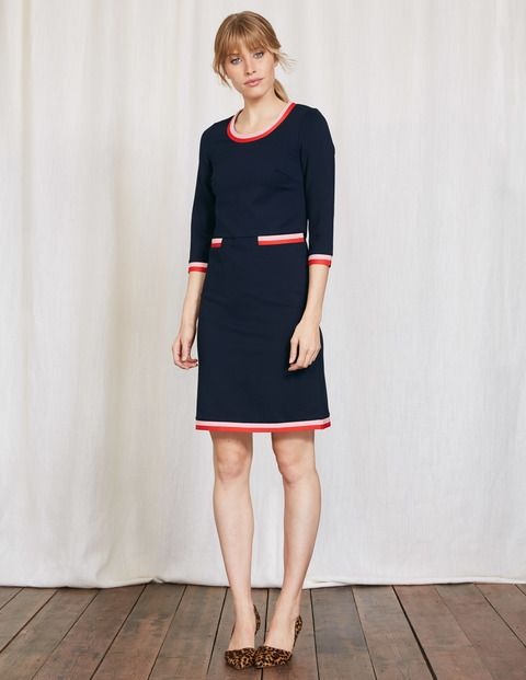 No wardrobe can be complete without a quality shift dress and this vintage-inspired design does the trick nicely. With a colourblock trim, it's both classic and quirky at the same time. Team with a pair of zip-up ankle boots for a head-to-toe retro look.