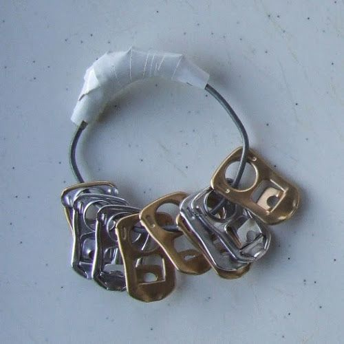 Shaker fro ring pulls.                            Gloucestershire Resource Centre http://www.grcltd.org/scrapstore/