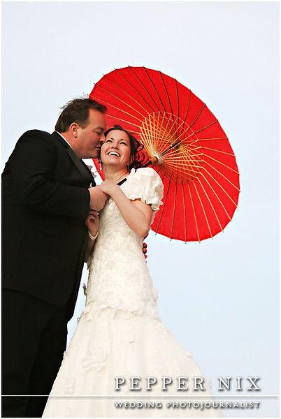 bride and groom photo idea with paper umbrella