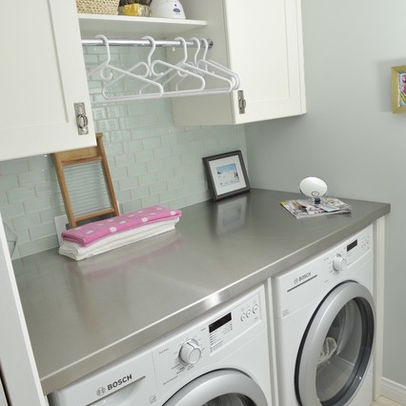I need a simple folding surface above my washer/dryer.  Also a hanging bar, but with much more space than the one shown here