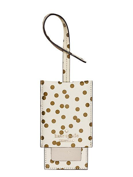 Kate Spade, cedar street confetti dot luggage tag - this chic leather luggage tag will help ensure that your suitcase always makes its way back to you.