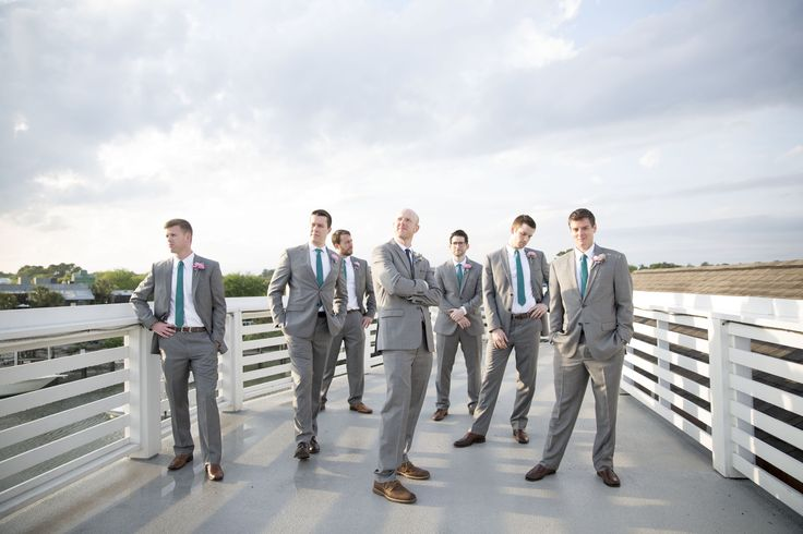 Groomsmen pose idea - GQ pose - grey suits brown shoes teal ties wedding party - Charleston Crafted