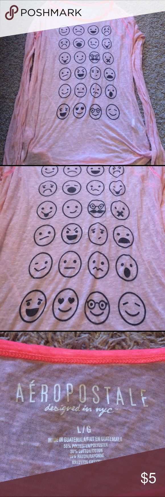 Pink transparent emoji top Light pink transparent long sleeve top with emojis on front. Made from 55% polyester, 30% cotton & 15% rayon. Unworn. Aeropostale Tops Blouses