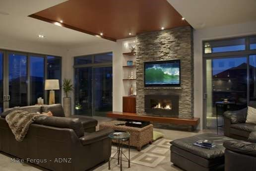 The perfect venue for that next rugby game!  House designed by Mike Fergus #adnz #designerliving #fireplace #architecture