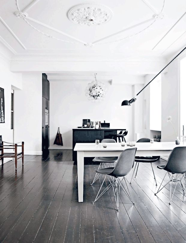 ornate ceiling wooden flooring lighting spacious white grey living table and chairs white walls