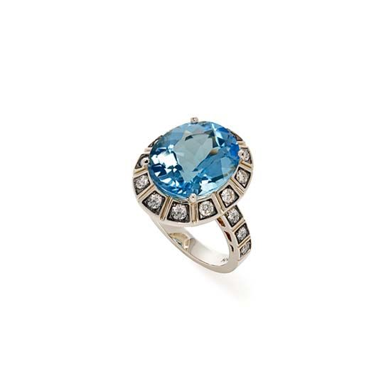 Anel de Ouro Nobre 18K com topázio azul e diamantes cognac - Coleção Maracanã http://m.hstern.com.br/joia/anel/maracana/A1TA203719