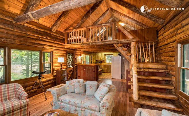 Lakefront log cabin rental set in forestry of adirondack
