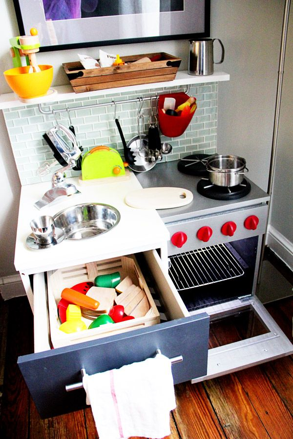 If I had a kid, I'd try to replicate this DIY Play Kitchen @ www.preparingforpeanut.com
