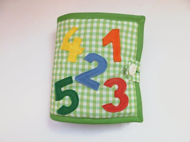 Quiet+book+čísla+a+tvary+Velikost+knížky+je+15x15cm.+Zapínání+na+knoflík.+Tvoří+5+dvojstránek.+Každá+dvojstránka+tvoří+číslo+atvary,+které+jsou+na+suchý+zip.+Knoflíky+a+korálky.+Knihaje+ušita+z+bavlny+a+jednotlivé+dílyjsou+ušité+z+filcu.+Kartaje+vypodložené+vatelínem+a+olemované+šikmým+proužkem.+Kniha+slouží+k+rozvoji+dětské+fantazie,+dovednosti,...
