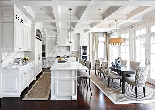 While maybe not quite on the scale of Grayson Manor, this kitchen and adjoining dining area designed by Laura Hay are certainly light and elegant enough for the Hamptons (photographed by Lisa Petrole)