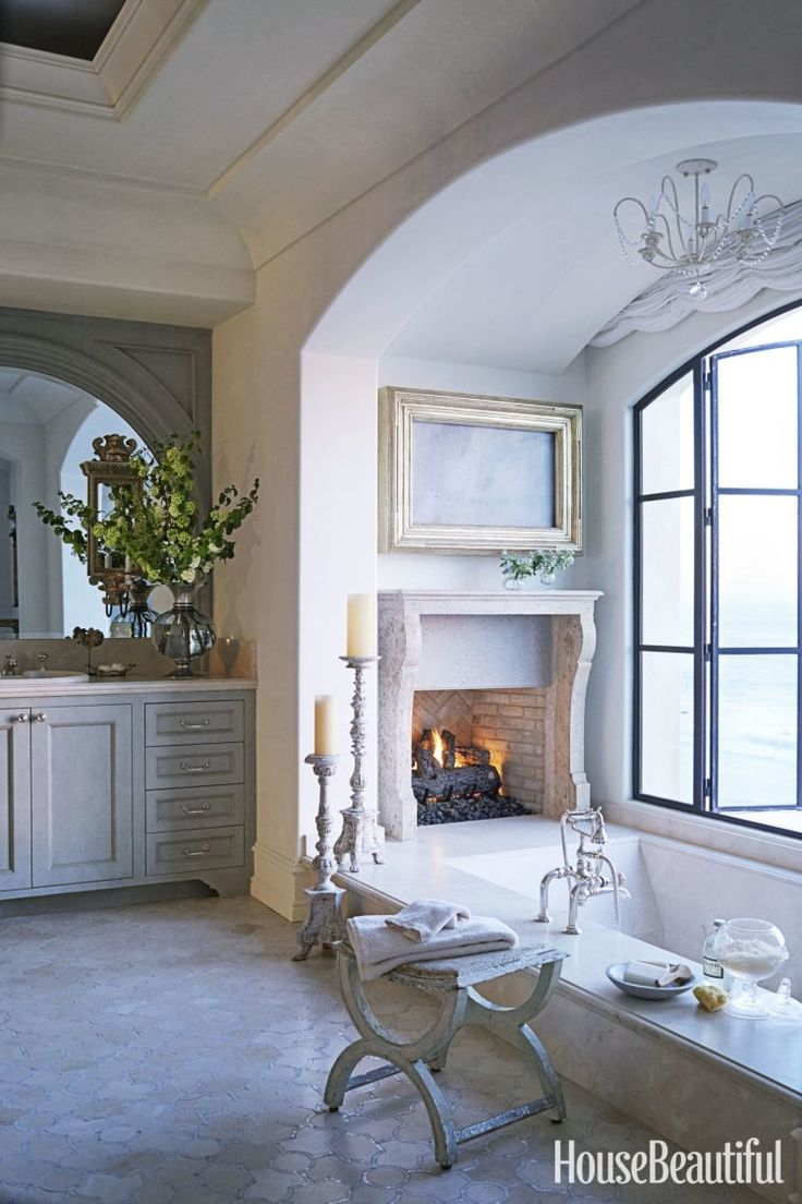 French country bathrooms - French Country Bathroom With A Wood Burning Fireplace