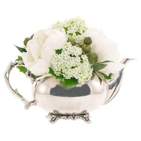 Faux white peony and snowball arrangement in a silver-hued teapot . That's what I'll do with those silver bowls that I've been collecting at the thrift stores.