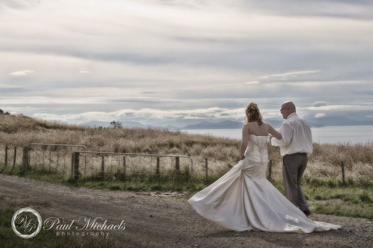 bride and groom walk together into the sunset at boomrock. PaulMichaels wedding photographers in Wellington. http://www.paulmichaels.co.nz/